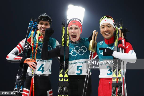 Bronze medalist Lukas Klapfer of Austria gold medalist Eric Frenzel of Germany and silver Akito Watabe of Japan celebrate the Nordic Combined...