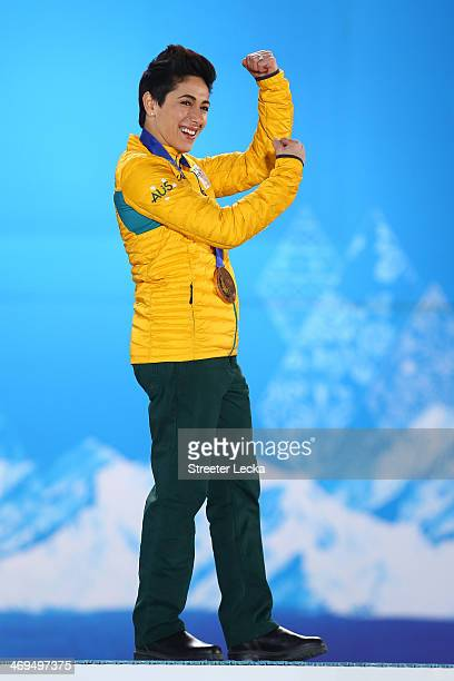 Bronze medalist Lydia Lassila of Australia celebrates on the podium during the medal ceremony for the Freestyle Skiing Ladies' Aerials on day 8 of...