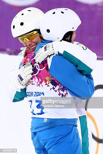 Bronze medalist Lydia Lassila of Australia hugs gold medalist Alla Tsuper of Belarus after the Freestyle Skiing Ladies' Aerials Finals on day seven...