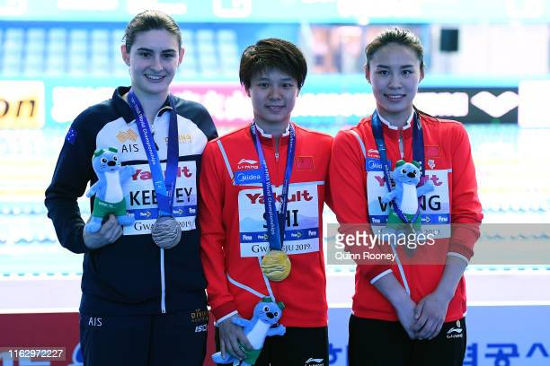 Bronze medalist Maddison Keeney of Australia gold medalist Tingmao Shi of China and silver medalist Han Wang of China pose during the medal ceremony...