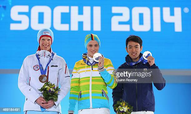 Bronze medalist Magnus Krog of Norway gold medalist Eric Frenzel of Germany and silver medalist Akito Watabe of Japan celebrate during the medal...
