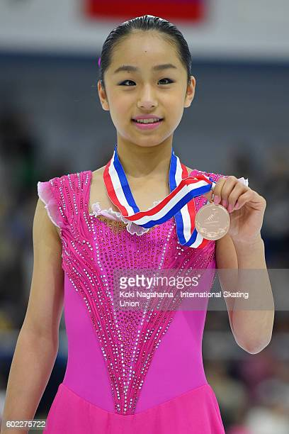 Bronze medalist Mako Yamashita of Japan poses for photographs on the podium after the medal ceremony during the ISU Junior Grand Prix of Figure...