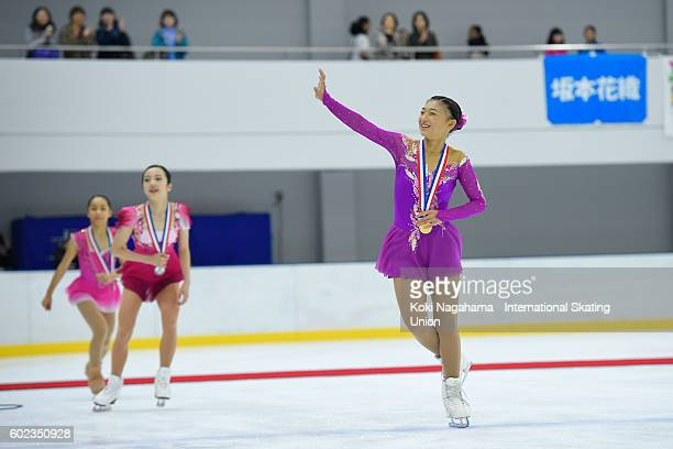 Bronze medalist Mako Yamashita of Japan Silver medalist Marin Honda of Japan and Gold medalist Kaori Sakamoto of Japan do a lap of honour after the...