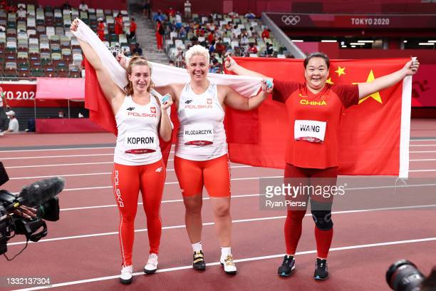 Bronze Medalist Malwina Kopron of Team Poland, gold medalist Anita Wlodarczyk of Team Poland and silver medalist Zheng Wang of Team China pose for a...