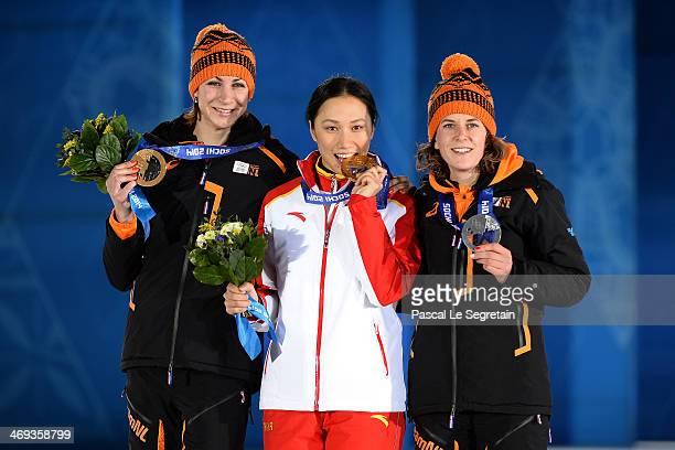 Bronze medalist Margot Boer of the Netherlands gold medalist Hong Zhang of China and silver medalist Ireen Wust of the Netherlands celebrate on the...