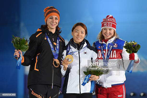 Bronze medalist Margot Boer of the Netherlands gold medalist Sang Hwa Lee of South Korea and silver medalist Olga Fatkulina of Russia celebrate on...
