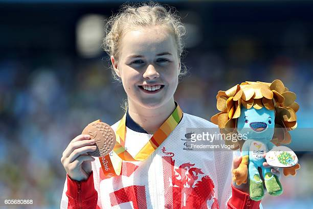 Bronze medalist Maria Lyle of Great Britain poses on the podium at the medal ceremony for the Women's 100m T35 on day 7 of the Rio 2016 Paralympic...