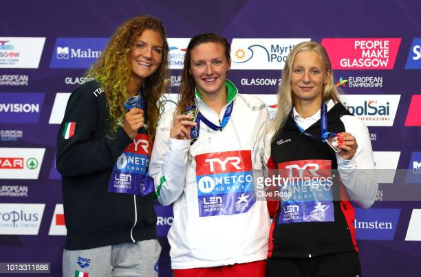 Bronze medalist Maria Ugolkova of Switzerland, Silver medalist Ilaria Cusinato of Italy, and Gold medalist Katinka Hosszu of Hungary pose with their...