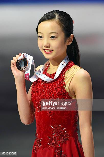Bronze medalist Marin Honda of Japan poses with her medal at the medal ceremony for the Junior Ladies Singles during day three of the ISU Grand Prix...