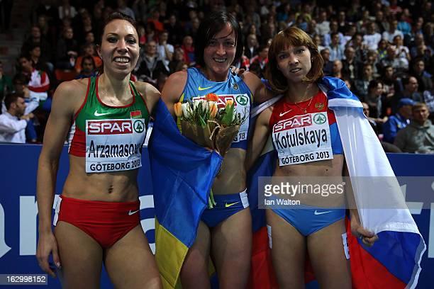 Bronze medalist Marina Arzamasova of Belarus Gold medalist Nataliya Lupu of Ukraine and silver medalist Elena Kotulskaia of Russia pose after the...
