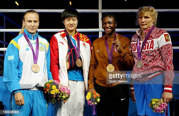 Bronze medalist Marina Volnova of Kazakhstan bronze medalist Jinzi Li of China gold medalist Claressa Shields of the United States and silver...