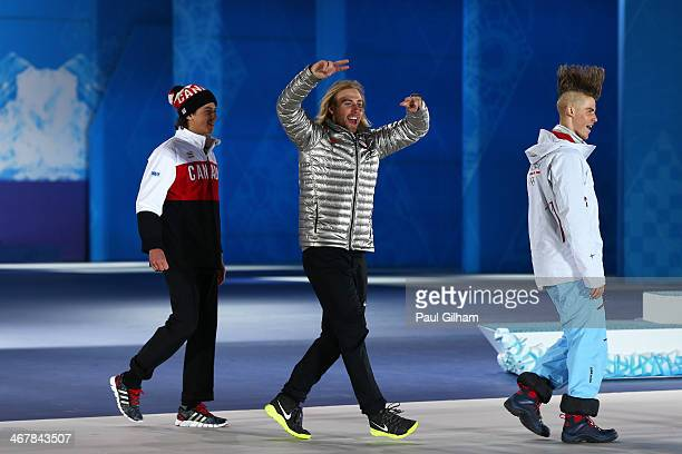 Bronze medalist Mark McMorris of Canada, gold medalist Sage Kotsenburg of the United States and silver medalist Staale Sandbech of Norway joke as...