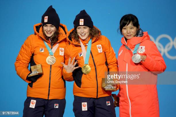 Bronze medalist Marrit Leenstra of the Netherlands gold medalist Ireen Wust of the Netherlands and silver medalist Miho Takagi of Japan pose during...