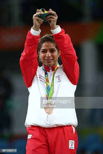 Bronze medalist Marwa Amri of Tunisia celebrates on the podium during the medal ceremony after the Women's Freestyle 58 kg competition on Day 12 of...