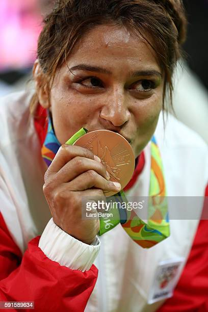 Bronze medalist Marwa Amri of Tunisia kisses her medal during the medal ceremony after the Women's Freestyle 58 kg competition on Day 12 of the Rio...