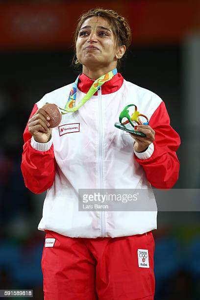 Bronze medalist Marwa Amri of Tunisia reacts on the podium during the medal ceremony after the Women's Freestyle 58 kg competition on Day 12 of the...