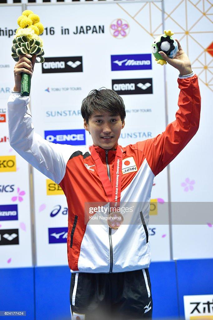 Bronze medalist Masaki Kaneko of Japn celebrates after Men's 200m Backstoke final race during the 10th Asian Swimming Championships 2016 at the Tokyo Tatsumi International Swimming Center/Tokyo Metropolitan Swimming Pool on November 18, 2016 in Tokyo, Japan.