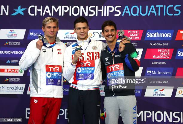 Bronze medalist Matteo Restivo of Italy Silver medalist Radoslaw Kawecki of Poland and Gold medalist Evgeny Rylov of Russia pose with their medals...