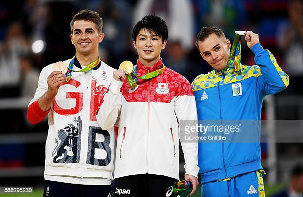 Bronze medalist Max Whitlock of Great Britain Gold medalist Kohei Uchimura of Japan and silver medalist Oleg Verniaiev of Ukraine pose for...