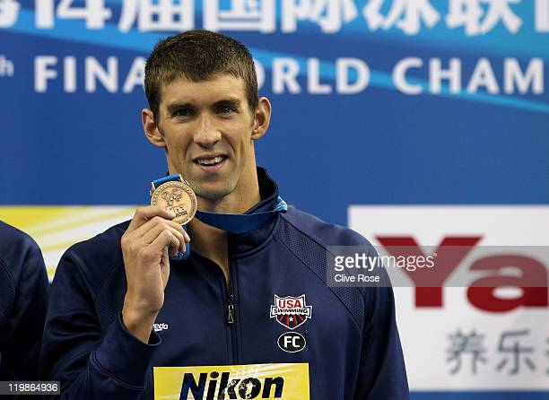 Bronze medalist Michael Phelps of the United States attends the medal ceremony for the Men's 4x100m Freestyle Relay during Day Nine of the 14th FINA...