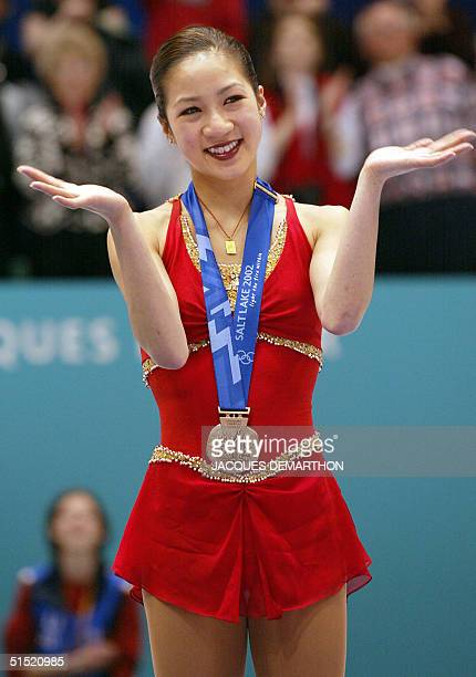 US bronze medalist Michelle Kwan stands on the podium after the women's figure skating event at the Olympic Ice Center 21 February 2002 during the...