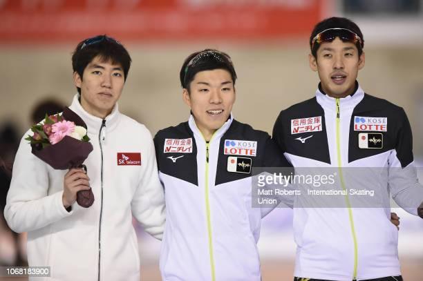 Bronze medalist Min Kyu Cha of South Korea gold medalist Tsubasa Hasegawa of Japan and silver medalist Ryohei Haga of Japan pose during the medal...