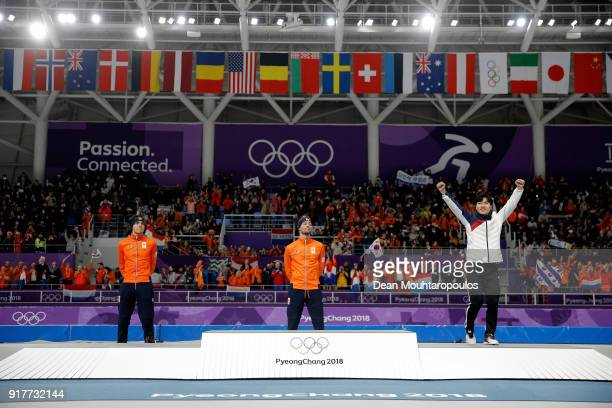 Bronze medalist Min Seok Kim of Korea celebrates with gold medalist Kjeld Nuis of the Netherlands and silver medalist Patrick Roest of the...