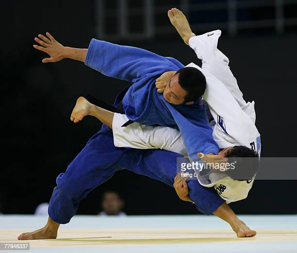 Bronze medalist Min Sun Aea of Korea competes with Xiang Han of China in the men's 81kg category during the Good Luck Beijing 2007 Judo Open at the...