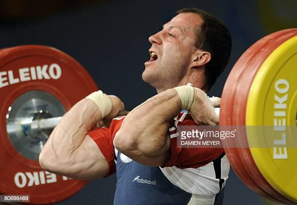 Bronze medalist Moldavia's Vladimir Popov competes in men 62 kg category during 2008 european weightlifting championships in Lignano Sabbiadoro on...