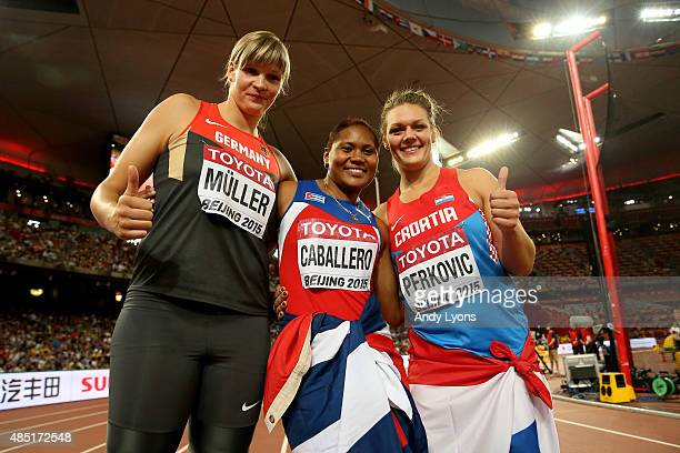 Bronze medalist Nadine Muller of Germany gold medalist Denia Caballero of Cuba and silver medalist Sandra Perkovic of Croatia celebrate after the...