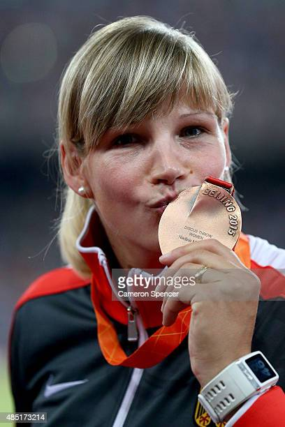 Bronze medalist Nadine Muller of Germany poses during the medal ceremony for the Women's Discus final during day four of the 15th IAAF World...