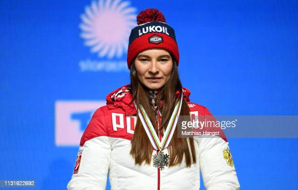 Bronze medalist Natalia Nepryaeva of Russia celebrates with her medal during the medal ceremony for the Cross Country Skiathlon Ladies 15k race of...