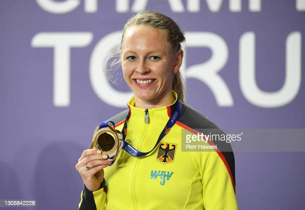 Bronze medalist Neele Eckhardt of Germany poses for a photo during the medal ceremony for Women's Triple Jump final during the second session on Day...