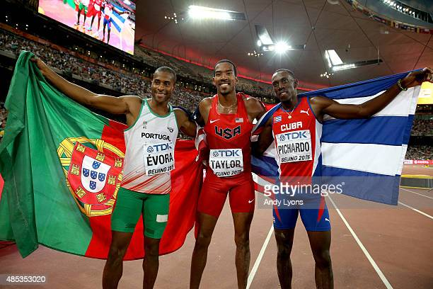 Bronze medalist Nelson Evora of Portugal gold medalist Christian Taylor of the United States and silver medalist Pedro P Pichardo of Cuba celebrate...