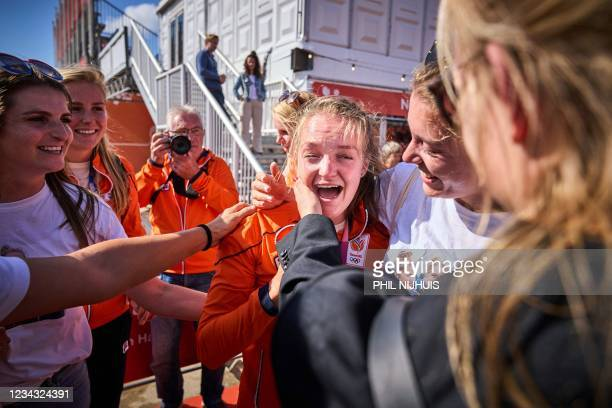 Bronze medalist Netherlands' Marieke Keijser is greeted as she arrives for a ceremony at the Olympic Festival in Scheveningen, on July 30, 2021. -...