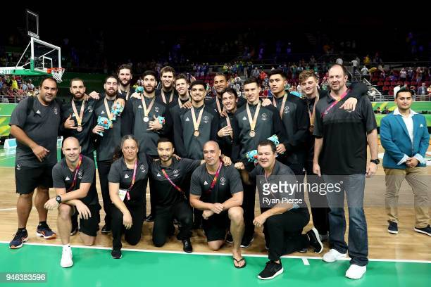 Bronze medalist New Zealand pose during the medal ceremony for the Men's Gold Medal Basketball Game between Australia and Canada on day 11 of the...