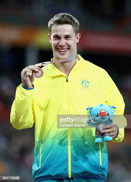 Bronze medalist Nicholas Hough of Australia poses during the medal ceremony for the Men's 110 hurdles during the Athletics on day six of the Gold...