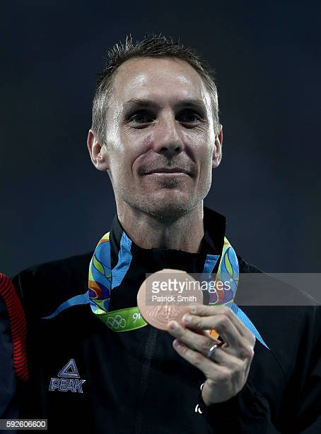 Bronze medalist Nicholas Willis of New Zealand stands on the podium during the medal ceremony for the Men's 1500 meter on Day 15 of the Rio 2016...