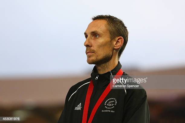 Bronze medalist Nick Willis of New Zealand pose on the podium during the medal ceremony for the Men's 1500 metres at Hampden Park during day ten of...