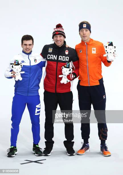 Bronze medalist Nicola Tumolero of Italy, gold medalist Ted-Jan Bloemen of Canada and silver medalist Jorrit Bergsma of the Netherlands celebrate...