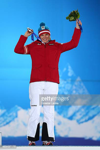 Bronze medalist Nicole Hosp of Austria celebrates during the medal ceremony for the Alpine Skiing Ladies' Super-G on day 8 of the Sochi 2014 Winter...