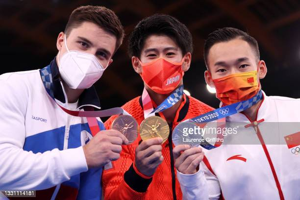 Bronze medalist Nikita Nagornyy of Team ROC, gold medalist Daiki Hashimoto of Team Japan and silver medalist Ruoteng Xiao of Team China pose with...