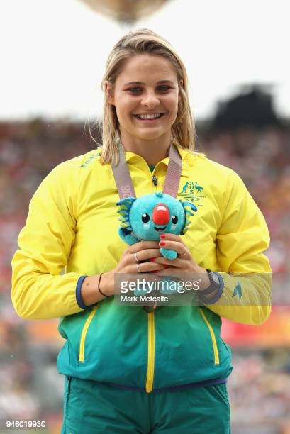 Bronze medalist Nina Kennedy of Australia celebrates during the medal ceremony for the Women's Pole Vault during athletics on day 10 of the Gold...