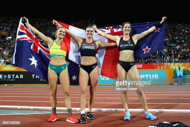 Bronze medalist Nina Kennedy of Australia gold medalist Alysha Newman of Canada and silver medalist Eliza McCartney of New Zealand celebrate after...