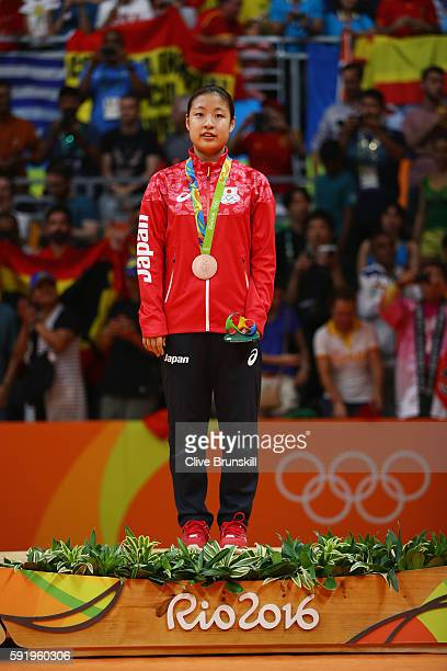 Bronze medalist Nozomi Okuhara of Japan celebrates during the medal ceremony after the Women's Singles Badminton competition on Day 14 of the Rio...