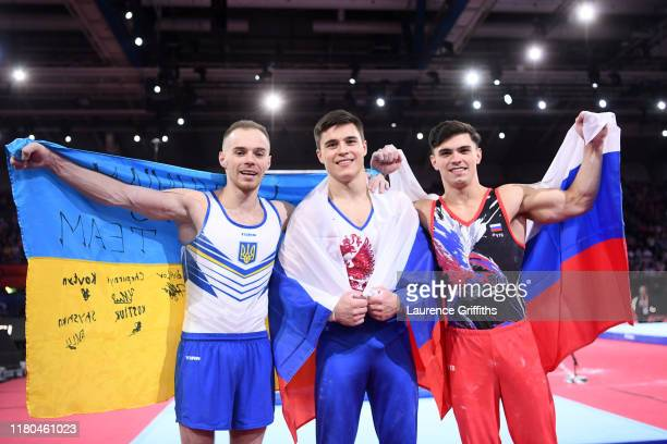 Bronze medalist Oleg Verniaiev of Ukraine gold medalist Nikita Nagornyy of Russia and silver medalist Artur Dalaloyan of Russia pose for photos...