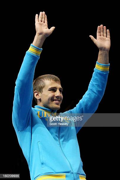 Bronze medalist Oleksandr Gvozdyk of Ukraine celebrates on the podium during the medal ceremony for the Men's Light Heavy Boxing final bout on Day 16...