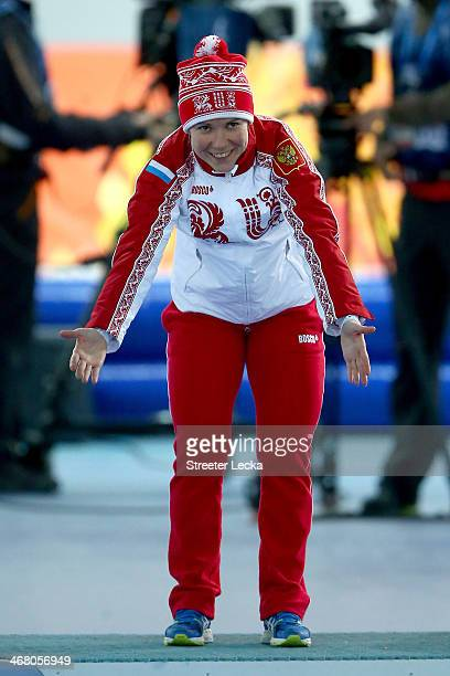 Bronze medalist Olga Graf of Russia celebrates on the podium during the flower ceremony for the Women's 3000m Speed Skating event during day 2 of the...