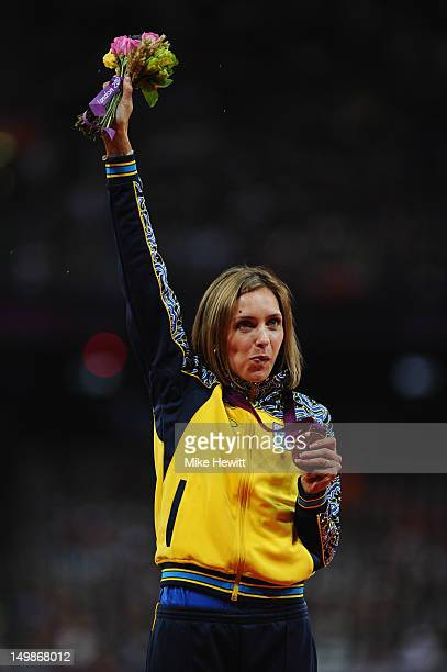 Bronze medalist Olha Saladuha of Ukraine poses on the podium during the medal ceremony for the Women's Triple Jump final on Day 9 of the London 2012...