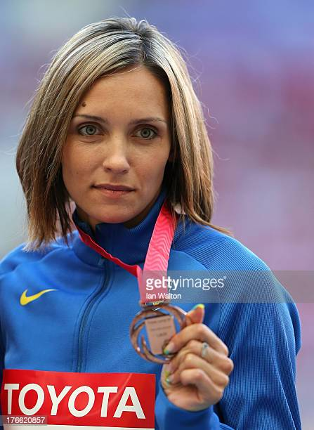 Bronze medalist Olha Saladuha of Ukraine stand on the podium during the medal ceremony for the Women's Triple Jump during Day Seven of the 14th IAAF...